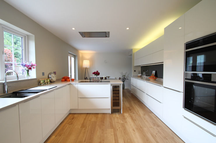 White gloss Schuller handled with Neff appliances and Ceaserstone worktops AD3 Design Limited Modern kitchen