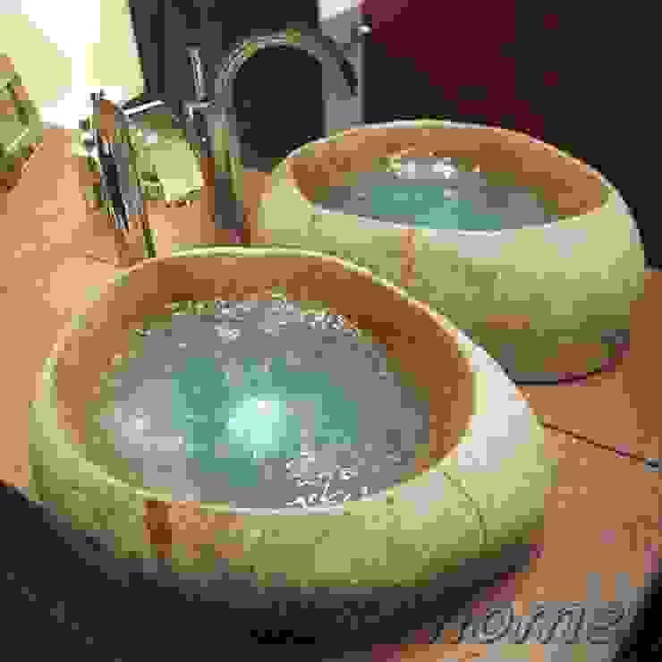 Stone sink de homify Moderno Piedra