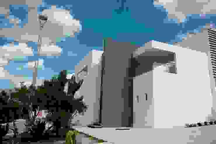 Fachada Casas de estilo minimalista de JF ARQUITECTOS Minimalista