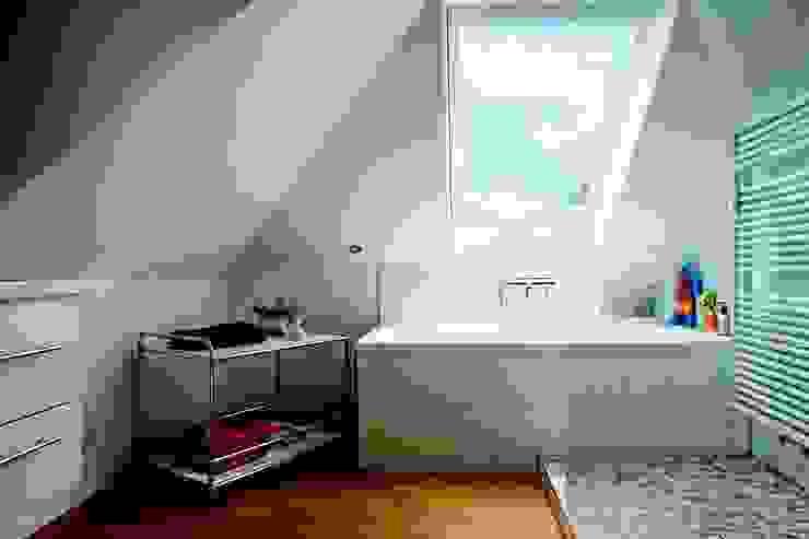 Baños de estilo  por USM Möbelbausysteme