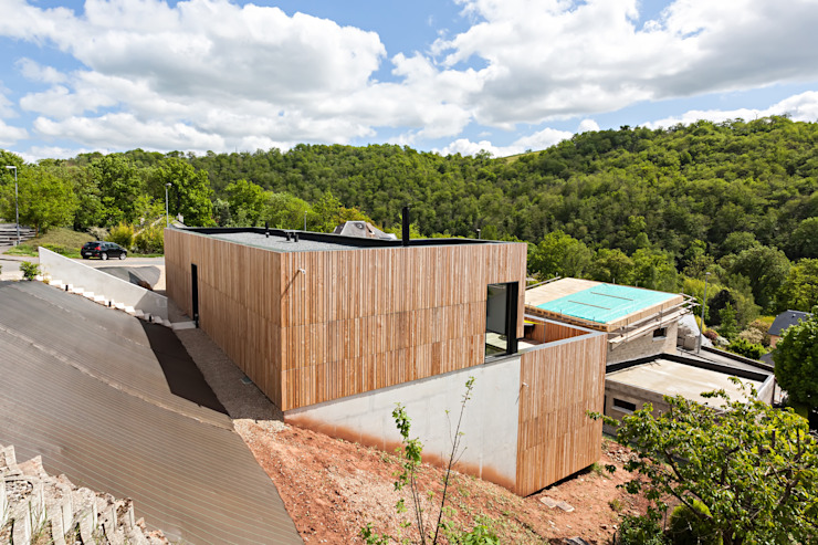 Casas minimalistas por Hugues TOURNIER Architecte Minimalista