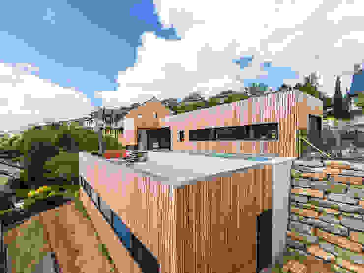 Huizen door Hugues TOURNIER Architecte,