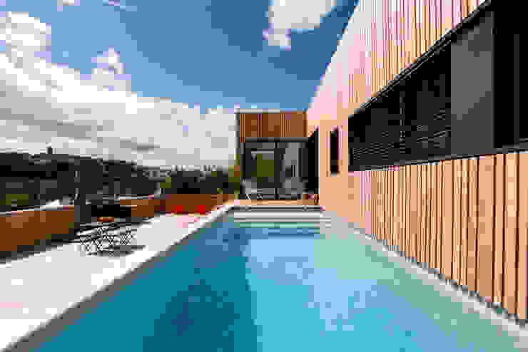 Minimalist pool by Hugues TOURNIER Architecte Minimalist