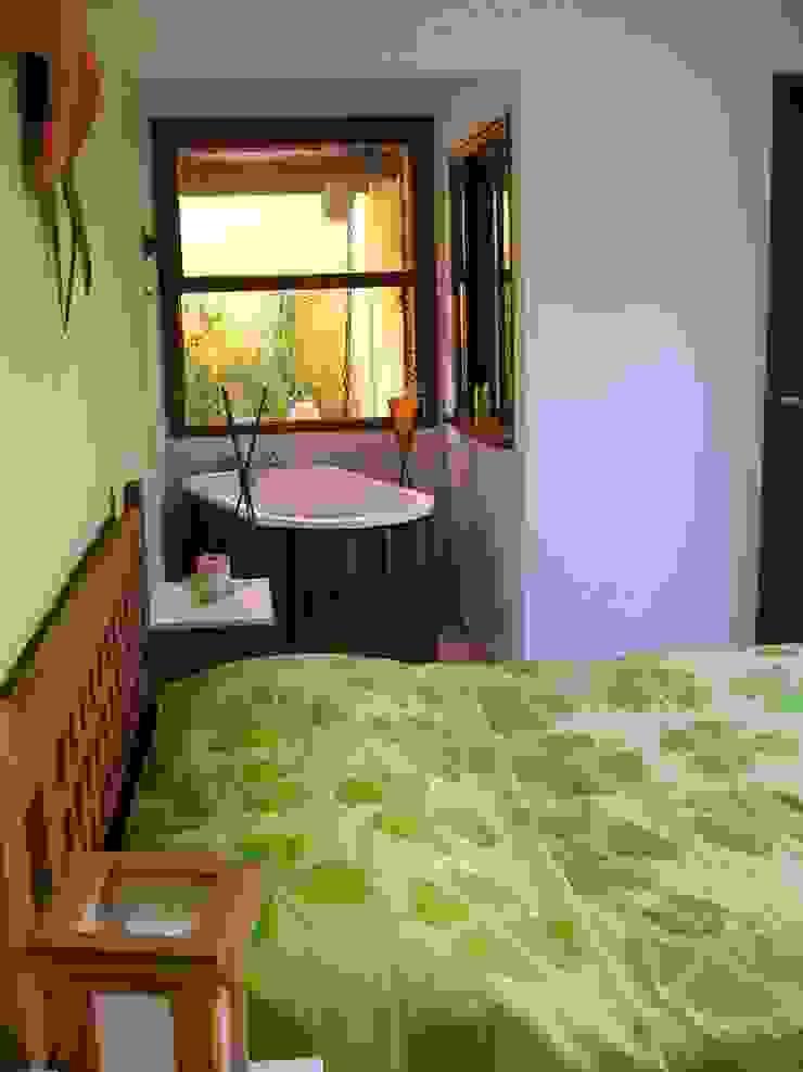 Metamorfose Arquitetura e Urbanismo Tropical style bedroom