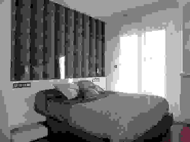 PROYECTO Y AMUEBLAMIENTO DE VIVIENDA EN GIPUZKOA. Dormitorios de estilo moderno de ERRASTI Moderno