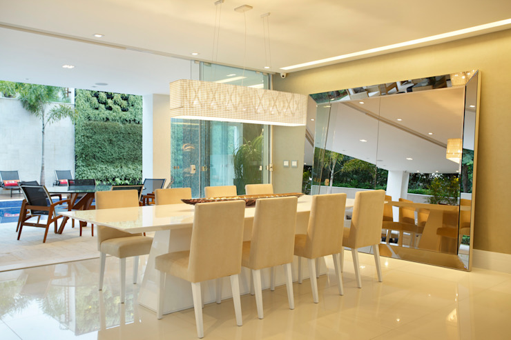 Modern dining room by Arquitetura e Interior Modern