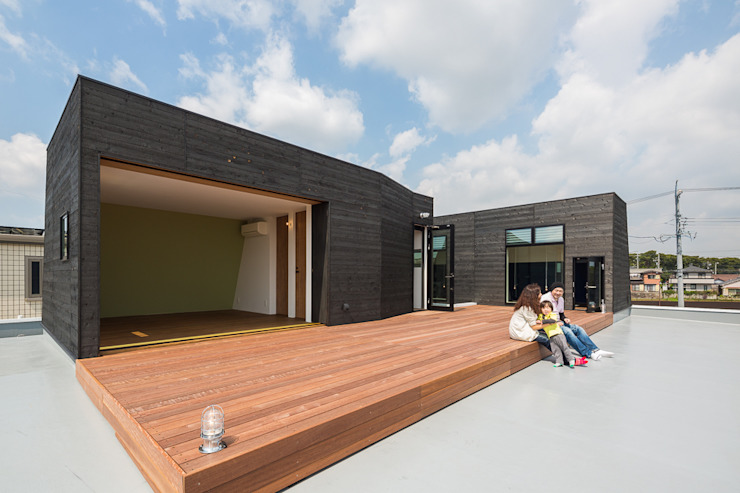 Jardines de estilo  de murase mitsuru atelier, Industrial