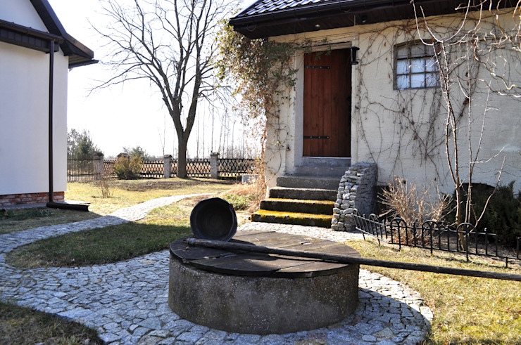 DOM POD LASEM: styl , w kategorii Ogród zaprojektowany przez Grzegorz Popiołek Projektowanie Wnętrz,Wiejski
