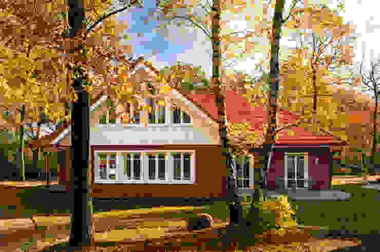Дома в стиле кантри от Haacke Haus GmbH Co. KG Кантри