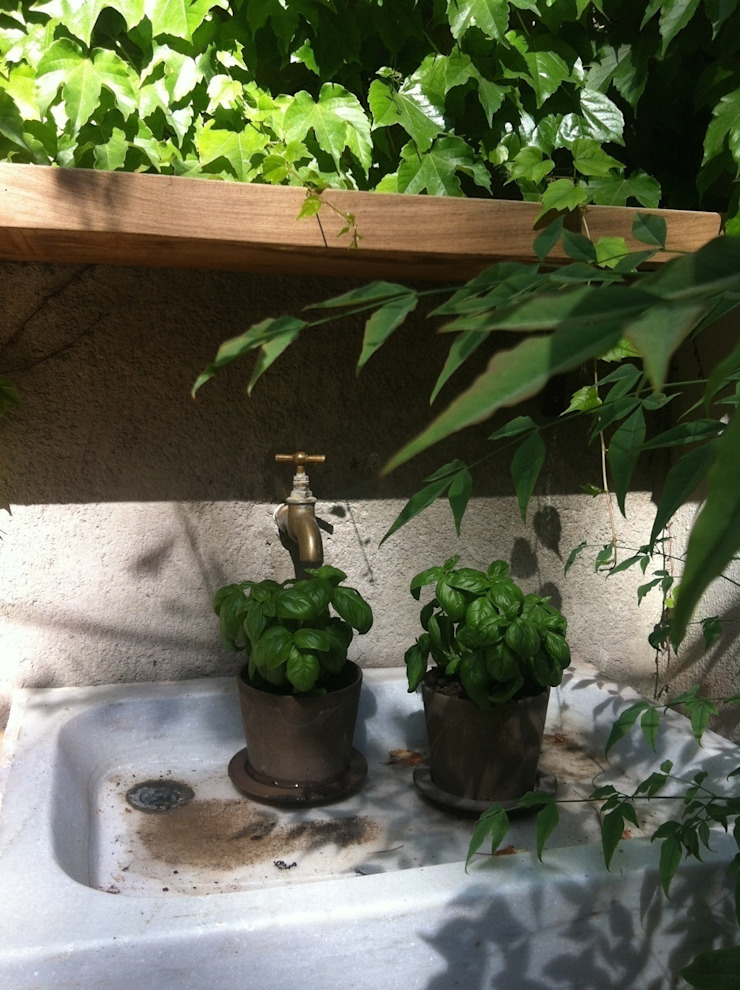 Reforma de un patio en Barcelona Jardines de estilo rústico de Asilvestrada Rústico