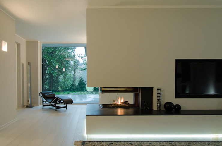 Living room by luogo comune, Minimalist