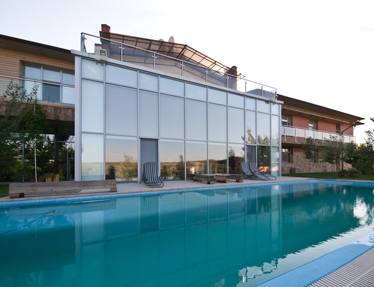 Casas ecléticas por Didenkül+Partners Eclético