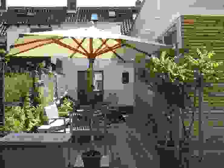 Terrasse mit Anabau und Altbau Moderne Häuser von RiekeGüntscheArchitekten BDA Modern