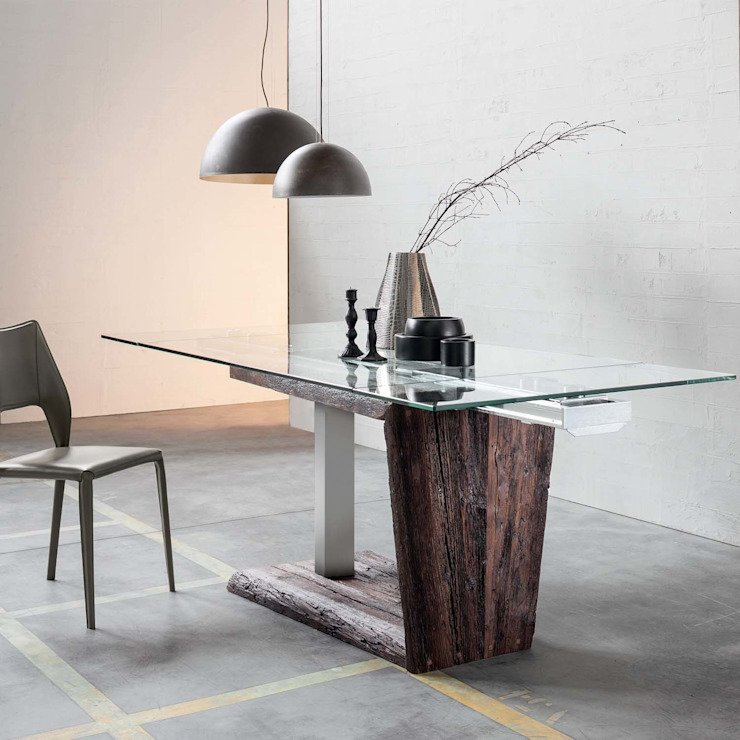 'Maso' extending glass top dining table by Sedit por homify Moderno