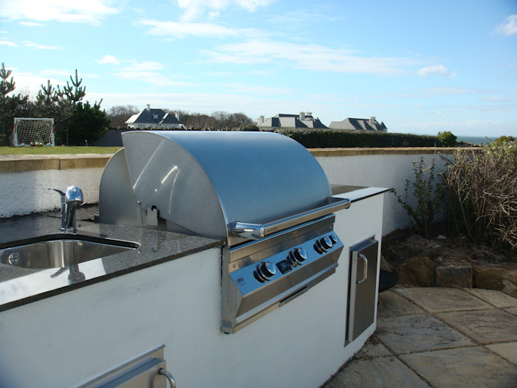 Outdoor Kitchen in a contemporary style. Modern garden by Design Outdoors Limited Modern
