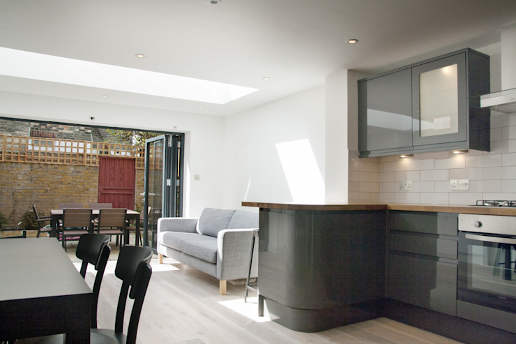 Open plan kitchen and living room Modern living room by GK Architects Ltd Modern