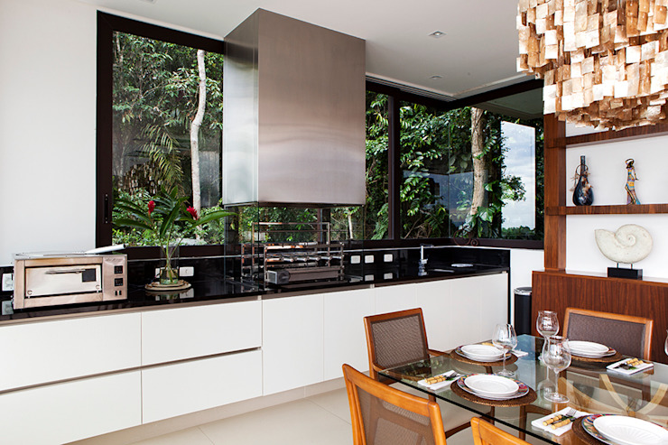 Modern kitchen by Infinity Spaces Modern