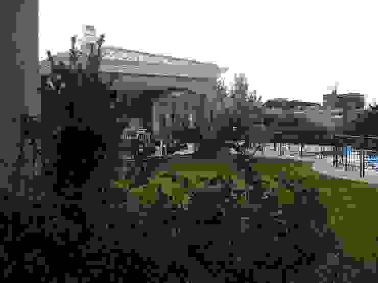 Requinte Jardins clássicos por Loro Arquitetura e Paisagismo Clássico