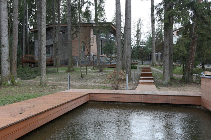 Вид на дом от пруда Дома в стиле минимализм от ORT-interiors Минимализм