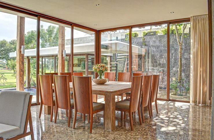 Tropical style dining room by Ancona + Ancona Arquitectos Tropical
