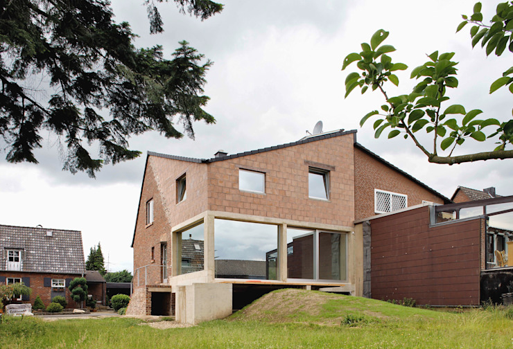 modern  door AMUNT Architekten in Stuttgart und Aachen, Modern