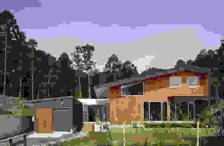 Modern houses by TAMAI ATELIER Modern