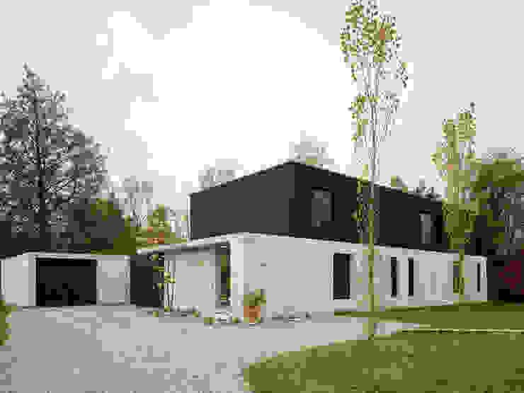 Eklektyczne domy od :mlzd Eklektyczny