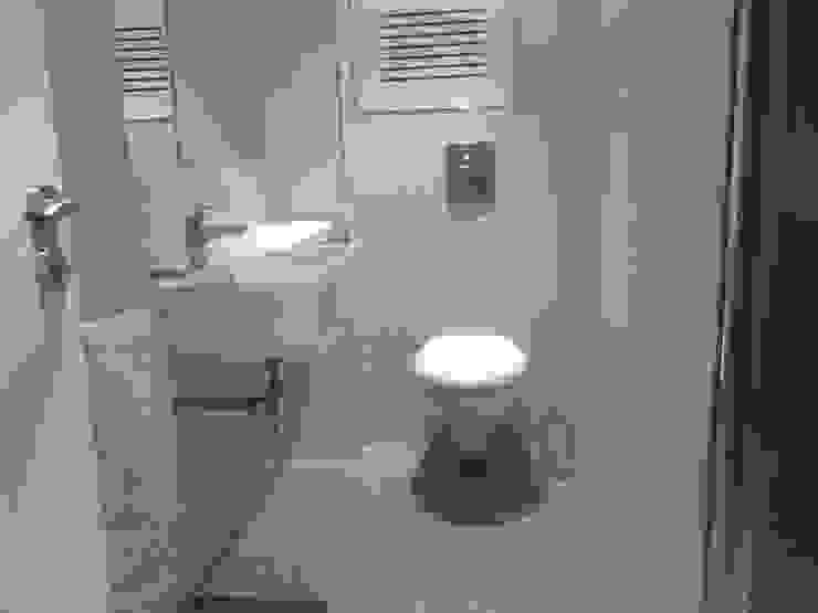 De aseo de cortesía a baño completo Baños de estilo moderno de Arquitectos Fin Moderno