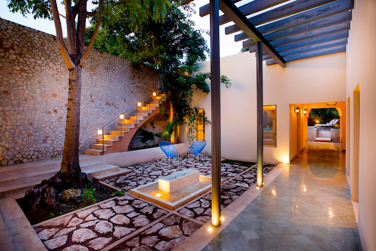 Colonial style garden by Taller Estilo Arquitectura Colonial