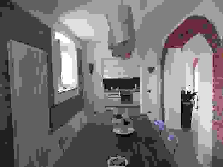Ristrutturazione e progetto interni di edificio rurale in Lunigiana - Toscana Sala da pranzo rurale di STUDIO TECNICO ASSOCIATO TONDIN Rurale
