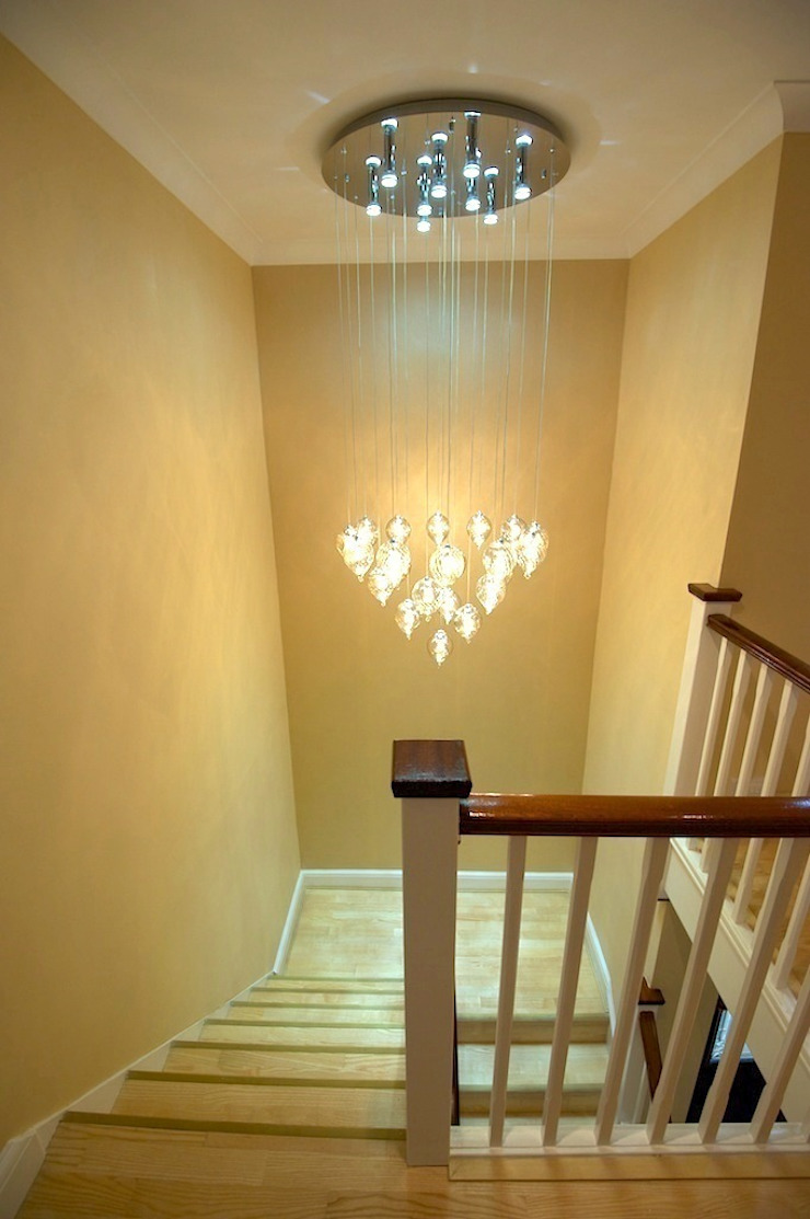 Statement light over staircase: modern  by Chameleon Designs Interiors, Modern