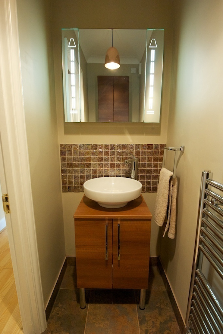 New cloakroom with feature handbasin: modern  by Chameleon Designs Interiors, Modern