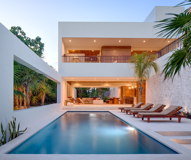 Casa Xixim Piscinas tropicais por Specht Architects Tropical