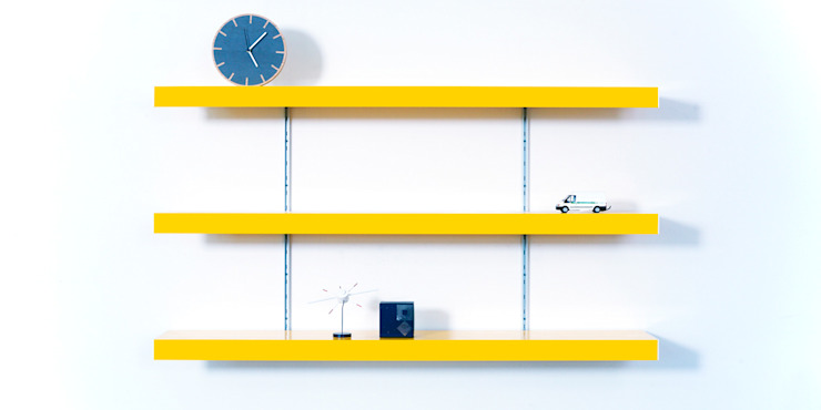 Colour shelving with silver anodised aluminium wall fixings homify SalonMeubles télévision & multimédia Métal Jaune