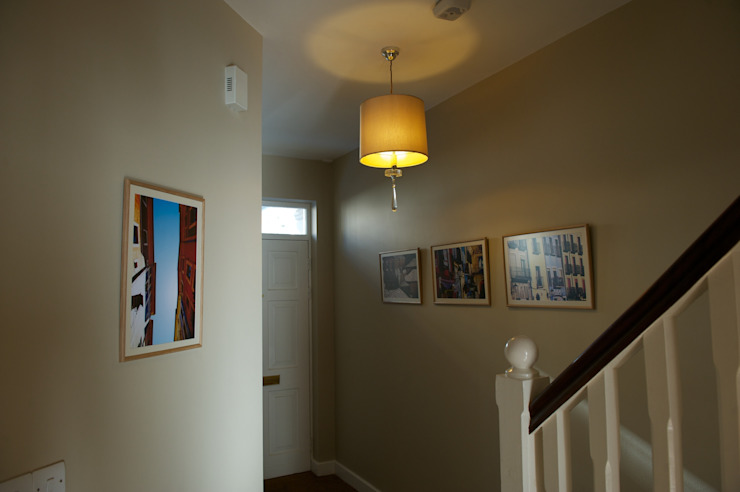 Entrance hall with statement lighting and artwork Modern corridor, hallway & stairs by Chameleon Designs Interiors Modern