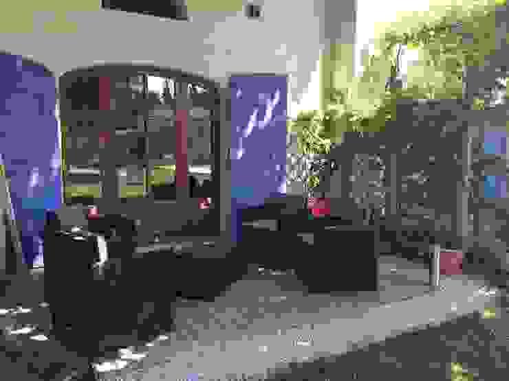 Terrasse ombragée Maisons modernes par L'Oeil DeCo Moderne