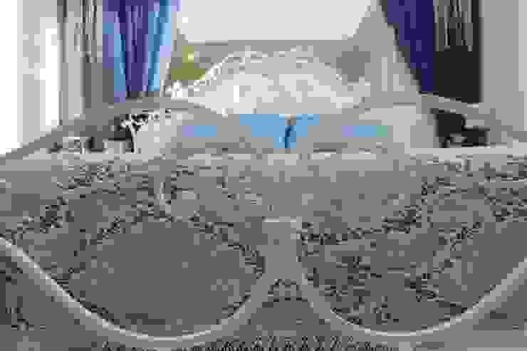 Фото кровати в интерьере спальни в квартире Спальня в классическом стиле от Дизайн студия Ольги Кондратовой Классический