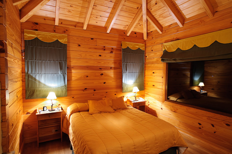 Country style bedroom by Patagonia Log Homes - Arquitectos - Neuquén Country Wood Wood effect