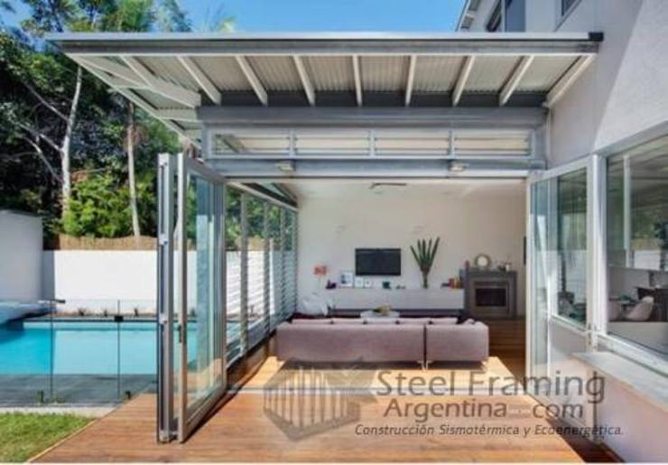 Interiores de Casas en Steel Framing Balcones y terrazas modernos: Ideas, imágenes y decoración de Steel Framing Argentina Moderno Hierro/Acero