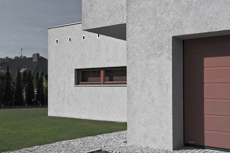 Projekt domu jednorodzinnego - Poznań: styl , w kategorii Domy zaprojektowany przez Konrad Idaszewski Architekt,Nowoczesny