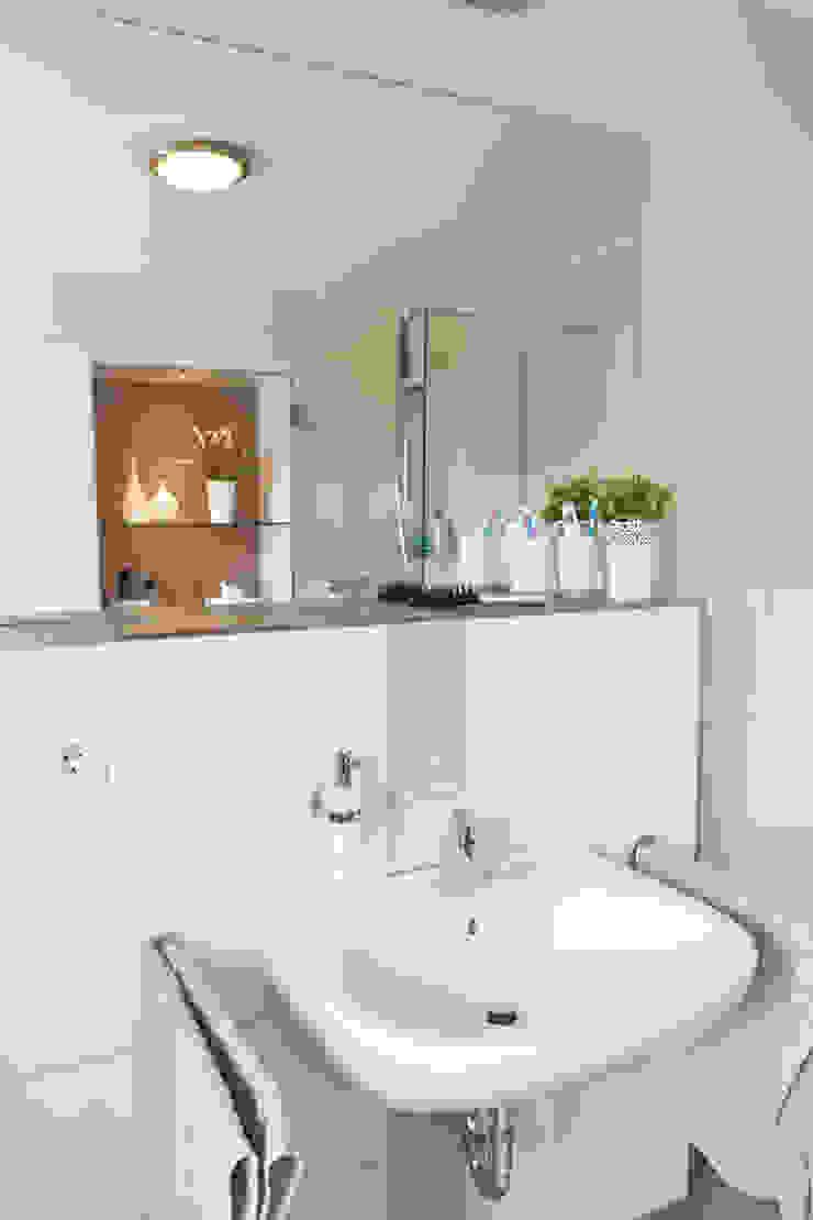 Waschtisch nach der Sanierung Maklerkontor Brand & Co. Immobilienmakler GmbH & Co. KG