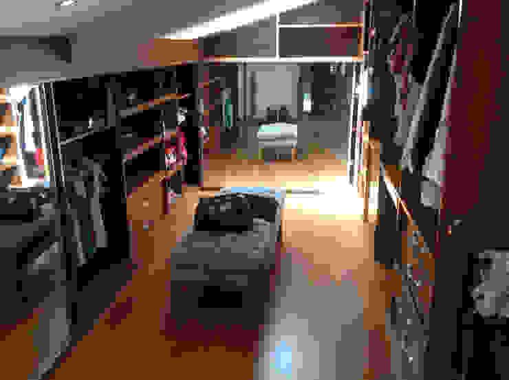 Closets por homify Moderno