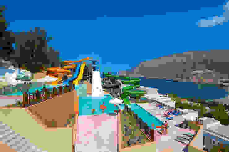FODELE BEACH & WATERPARK HOLIDAY RESORT, HERAKLION /GREECE <q>design by Tulay TOSUN</q> Modern Oteller Palmiye Peyzaj Mimarlık Modern