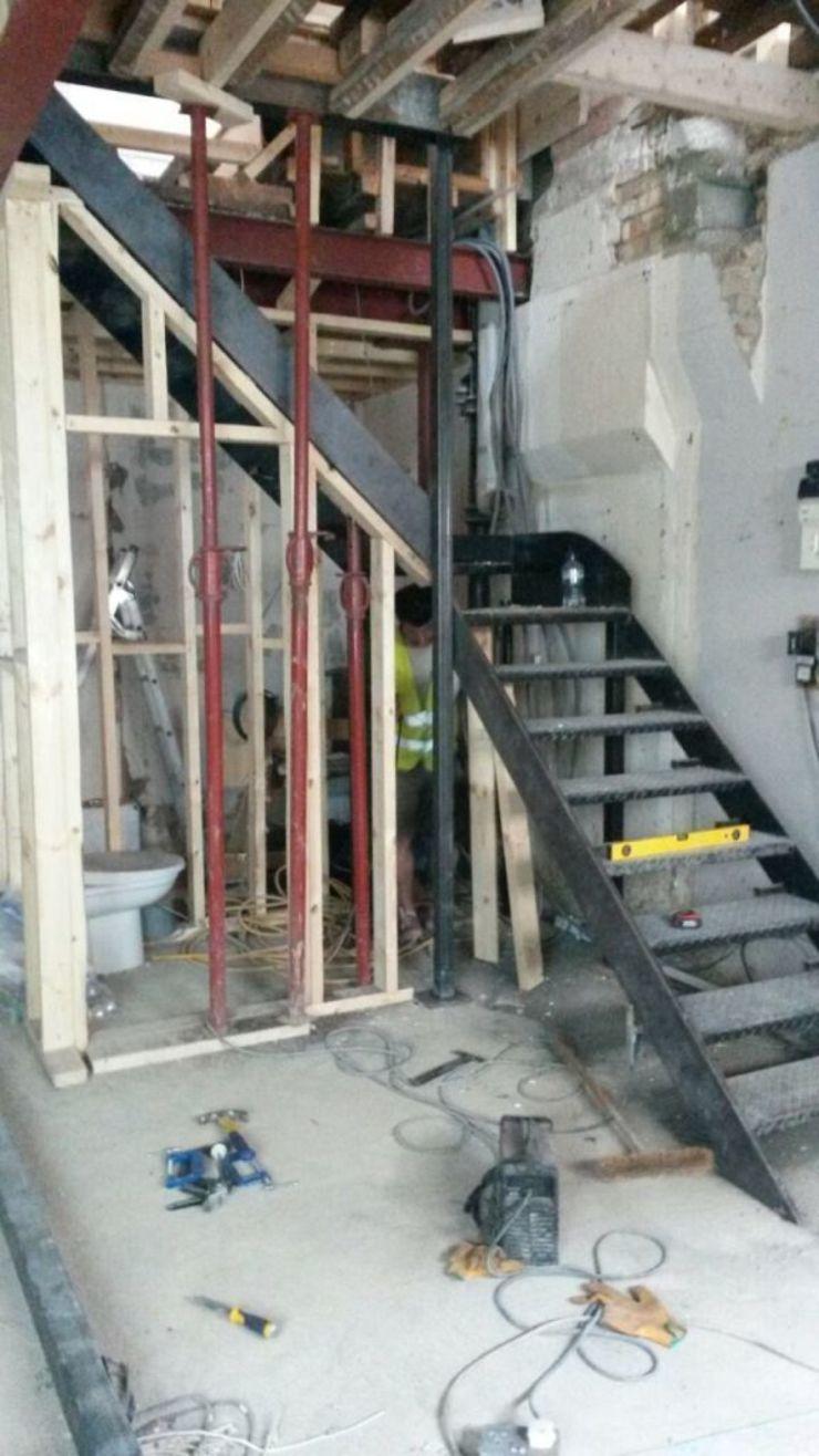 THE NEW STAIRCASE GOING IN - BEFORE THE STEELS WERE DRESSED IS AND REN STUDIOS LTD