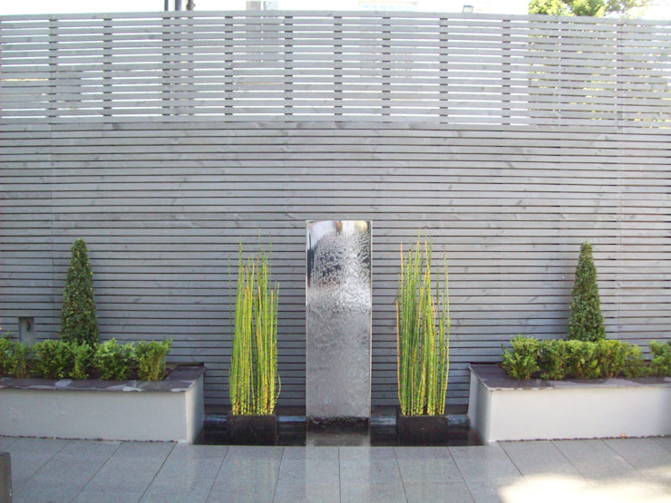 Stainless Steel Metal Water Feature Jardins modernos por Unique Landscapes Moderno