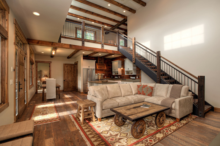 Lucky 4 Ranch:  Living room by Uptic Studios, Rustic