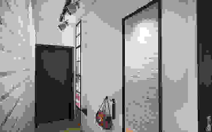 Pasillos, vestíbulos y escaleras de estilo industrial de Circle Line Interiors Industrial