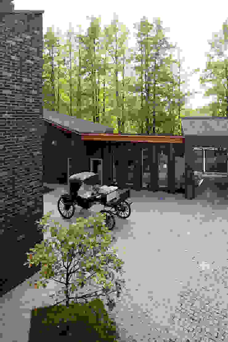 Загородный дом Подмосковье Дома в эклектичном стиле от Анахина Эклектичный