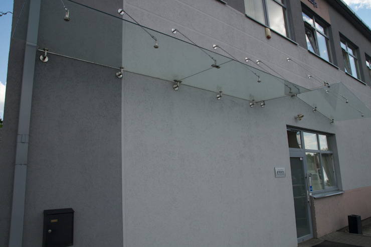 Glass Canopy with wall-suspended supports Inox City Ltd Modern office buildings