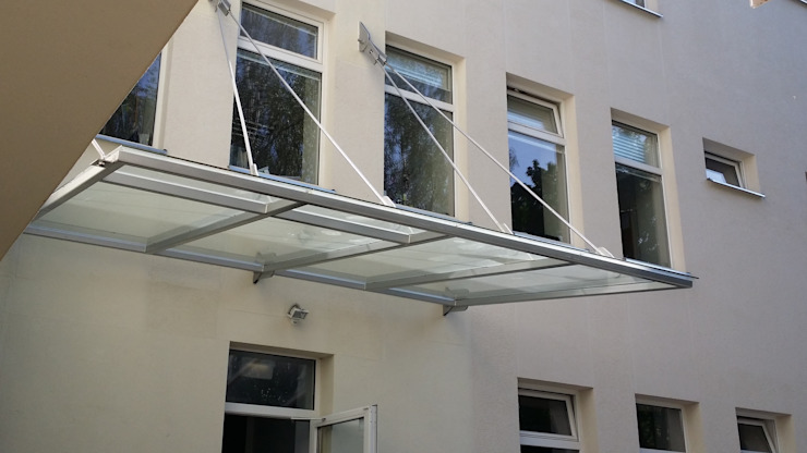 Glass Canopy with wall-suspended supports Inox City Ltd Modern schools